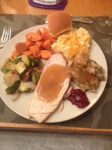 Roasted Turkey Breast with Pan Gravy, Roasted Brussel Sprouts with Carmelized Onions & Bacon, Roasted Sweet Potatoes, Cheesy Cauliflower Casserole, and Chicken Sausage Stuffing with 1 roll.